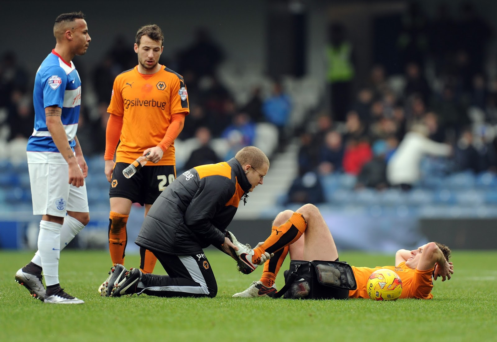 Phil Haywveard assessing Dave Edwards' leg